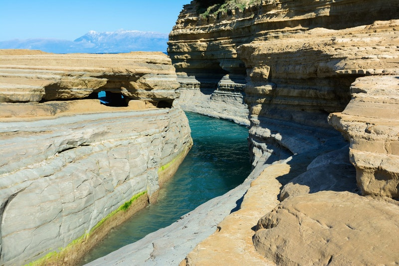 must-do-experiences-in-corfu-canal-damour-beach-daytrip4u